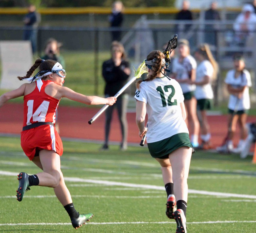 . Paul DiCicco - The News-Herald  Lake Catholic\'s Emily Osborne takes off toward the sideline, but is hounded by Mentor\'s Katelym Stuart the whole way.