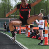 Michael Johnson - The News-Herald<br /> C'era Grimes of Harvey performs in the Long Jump Event during the CVC Chagrin division Track and Field Championships at Orange High School on May 11, 2016.