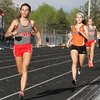 Michael Johnson - The News-Herald<br />  Geneva's Brittany Aveni (left) passes Chagrin's Halle McClintock during the Girls 800 meter race in the CVC Chagrin division Track and Field Championships at Orange High School on May 11, 2016.