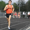 Michael Johnson - The News-Herald<br /> Joe Bistritz of Chagrin Falls leads during the Boys 1600 meter race in the CVC Chagrin division Track and Field Championships at Orange High School on May 11, 2016.