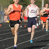 Michael Johnson - The News-Herald<br /> Joe Bistritz of Chagrin passes West Geauga's Dakota Medley to win the Boys 800 meter race in the CVC Chagrin division Track and Field Championships at Orange High School on May 11, 2016.