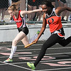 Michael Johnson - The News-Herald<br />  Perry's Emily Holroyd and Orange's Jasmine Harris finish the Girls 4 x 200 meter relay in a photo finish during the CVC Chagrin division Track and Field Championships at Orange High School on May 11, 2016.