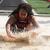 Michael Johnson - The News-Herald<br /> Harvey's Kierra Axxon lands in the Long Jump Event during the CVC Chagrin division Track and Field Championships at Orange High School on May 11, 2016.