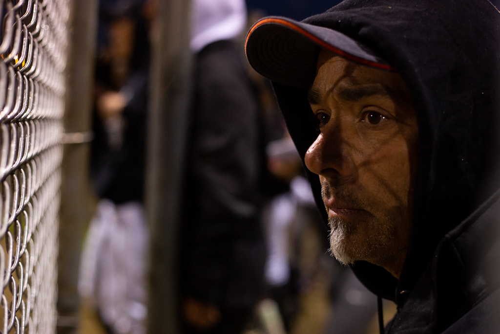 . Michael Johnson - The News-Herald Tom Braddock, North High School head coach, watches his team from the dugout