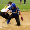 Barry Booher - The News-Herald<br /> Madison's Emma Burkholder beats the throw to Riverside third baseman Alexis Lavdis.