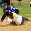Barry Booher - The News-Herald<br /> Riverside's Allie Goldy slides by the tag of Madison second baseman Samantha Tromba.