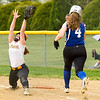 Barry Booher - The News-Herald<br /> Riverside's Allie Binkiewicz grabs the high throw, as Madison's Aly Berry is out at first.