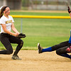 Barry Booher - The News-Herald<br /> The ball gets by Riverside's Jessica Kovalchuk, as Madison's Emma Burkholder slides into second .