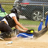 Barry Booher - The News-Herald<br /> Riverside's Alexis Vargas, blocks home plate and tags out Madison's Gabby Blackford.