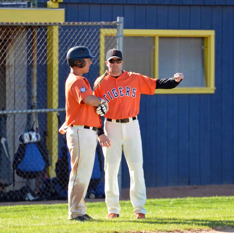 . Paul DiCicco - The News-Herald  Chagrin Falls Head Coach, Michael Sweeney, talks strategy with his batter, Colin Kennedy.