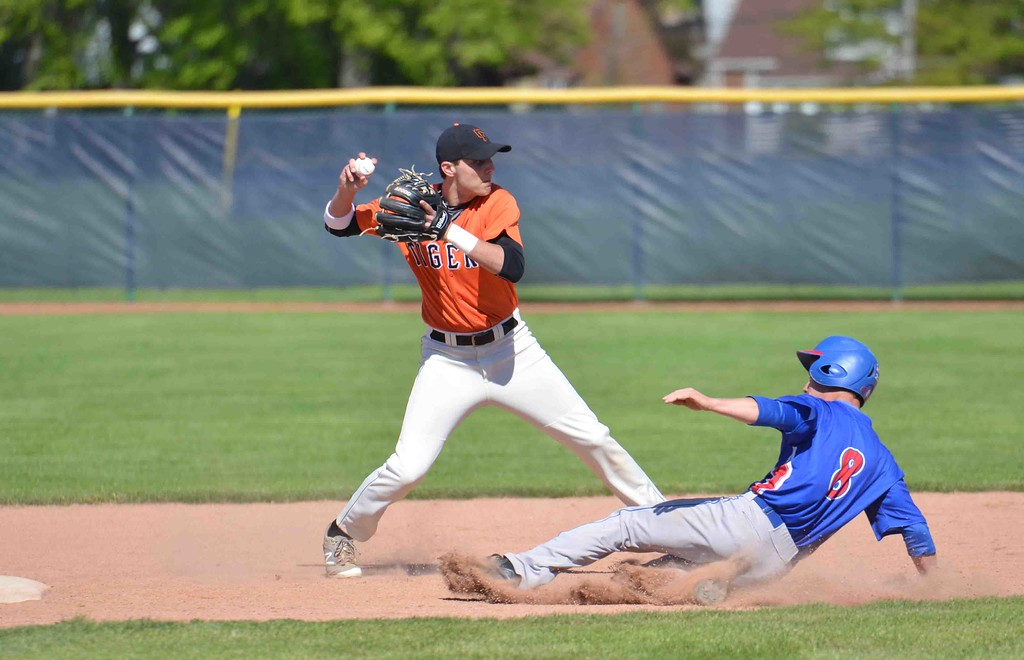 . Paul DiCicco - The News-Herald Chagrin Falls shortstop, Adam Bencko attempting a double-play in the first inning against Ravenna on May 15.