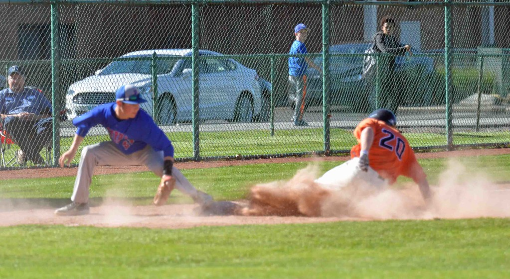 . Paul DiCicco - The News-Herald Tiger Freshman, Kyle Zaluski, sliding in safely at third.