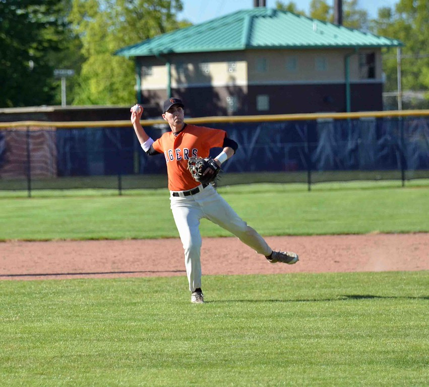 . Paul DiCicco - The News-Herald Tiger shortstop, Adam Bencko, fields and throws out a Raven hitter late in the game.