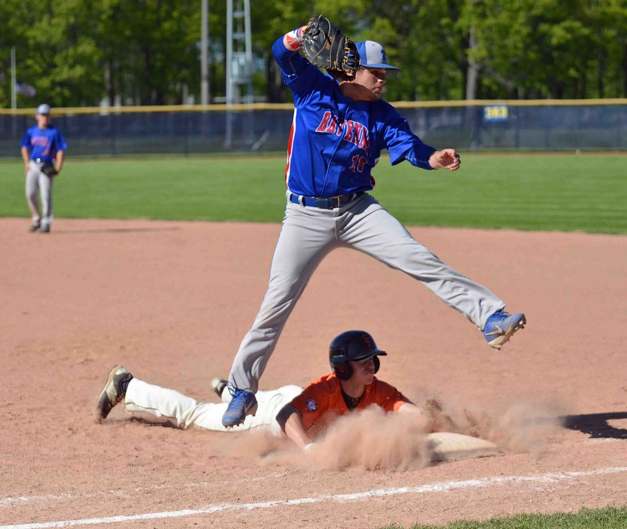 . Paul DiCicco - The News-Herald  Chagrin Falls senior, Andrew Kwasny, dives back to the bag and on the over-throw heads to second base.