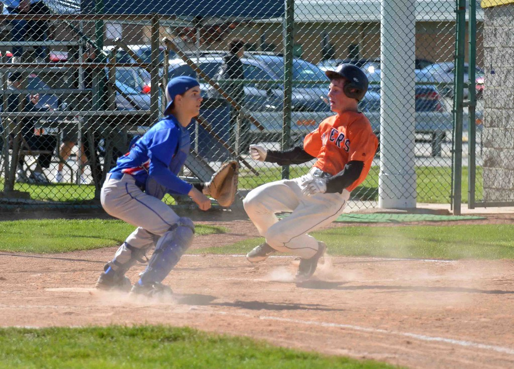 . Paul DiCicco - The News-Herald  A Chagrin Falls base-runner sliding home safely early in the game to make it 1-0.