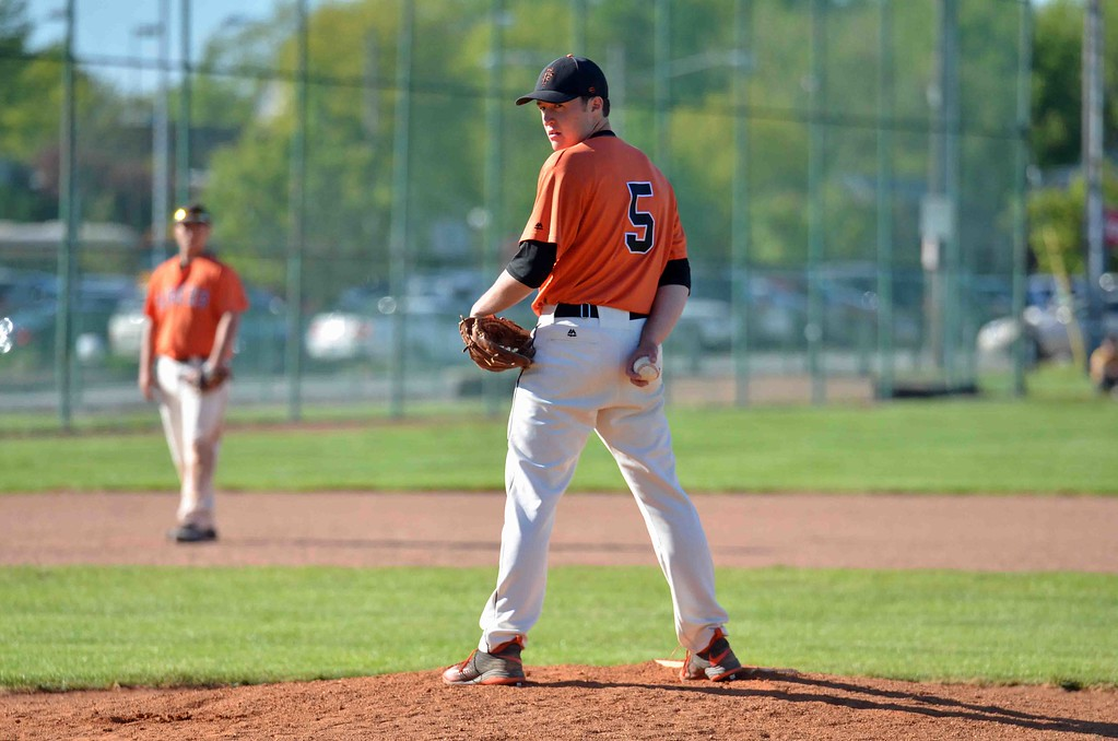 . Paul DiCicco - The News-Herald  Tiger pitcher, Erik Wilson, looks back the runner at first base.