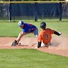 Paul DiCicco - The News-Herald<br /> Chagrin Falls center fielder Jack Amendola, sliding in ahead of the tag.