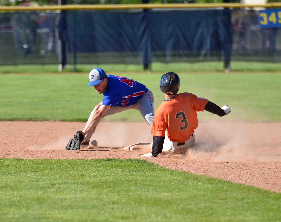 . Paul DiCicco - The News-Herald Chagrin Falls center fielder Jack Amendola, sliding in ahead of the tag.