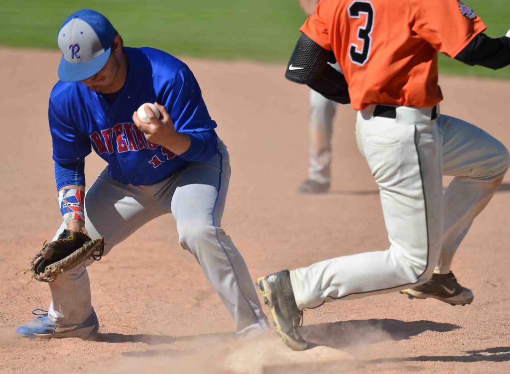 . Paul DiCicco - The News-Herald  Chargin Falls sophomore, Jack Amendola, beats out a bobbled ball by the first baseman.