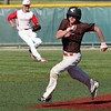 Randy Meyers - The Morning Journal<br /> Jake Case of Buckeye runs to third   on a base hit against Firelands on Monday afternoon in Parma Hts