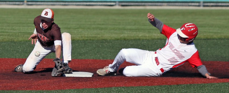 Randy Meyers - The Morning Journal<br /> Buckeye infielder Jonathon Neel  bobbles the ball and Colin Ransom of Firelands slides into second safely on  Monday.