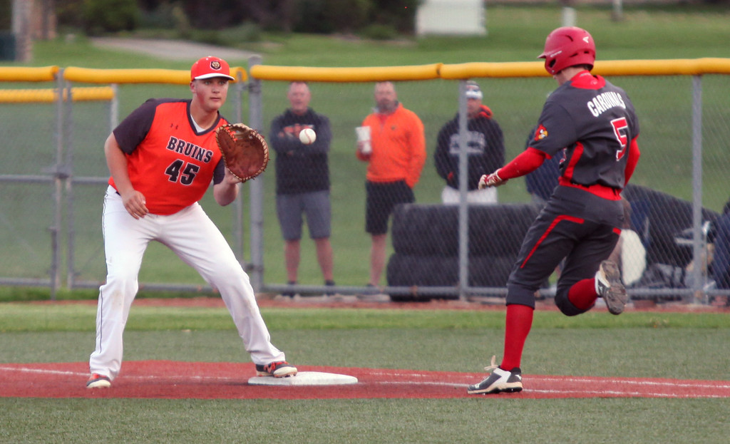 . Randy Meyers - The Morning Journal<br> Padua first baseman Hank Neumann makes the catch for the out as Brookside\'s Connor Baughman runs down the line on May 15.