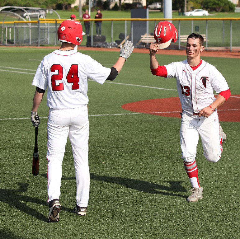 . Randy Meyers - The Morning Journal<br> Alex Brill of Firelands is congratulated by Aaron Urban after scoring against Rocky River on May 15.