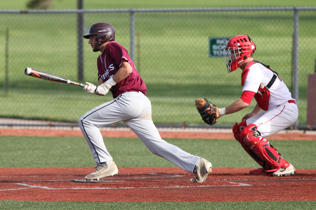. Randy Meyers - The Morning Journal<br> Cam Blue of Rocky River lines a hit against Firelands on May 15.