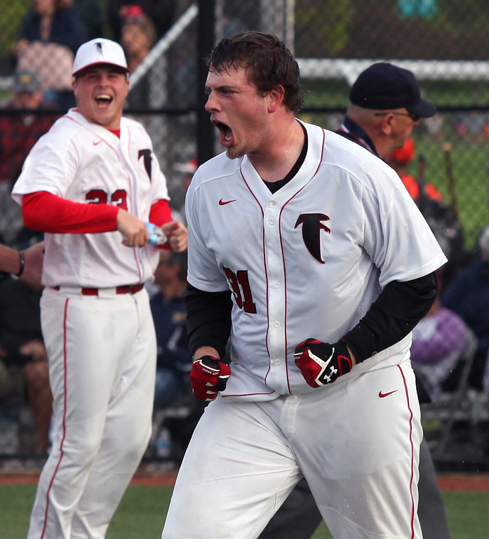 . Randy Meyers - The Morning Journal<br> Calvin Stull of Firelands celebrates after hitting in the winning run in the bottom of the eighth inning against Rocky River on May 15.