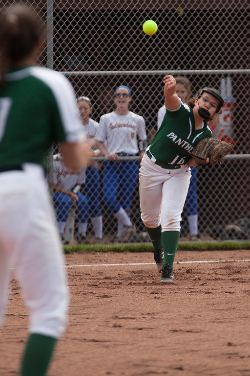 . Jen Forbus - The Morning Journal<br> Elyria Catholic third baseman Faith Beiza makes a throw to first in Elyria\'s Catholic\'s district semifinal game against the Independence Blue Devils on May 15.