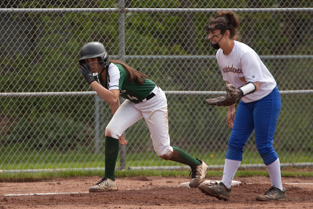 . Jen Forbus - The Morning Journal<br> Elyria Catholic\'s Kaylie Griffin is ready to head home while Independence\'s third baseman, Maggie George, keeps her close on May 15.