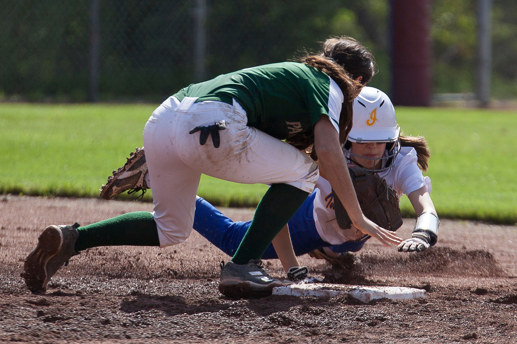 . Jen Forbus - The Morning Journal<br> Elyria Catholic short stop Stephanie Griffin makes the tag against Independence\'s Morgan Pascarella who was trying to get back to second base on May 15.