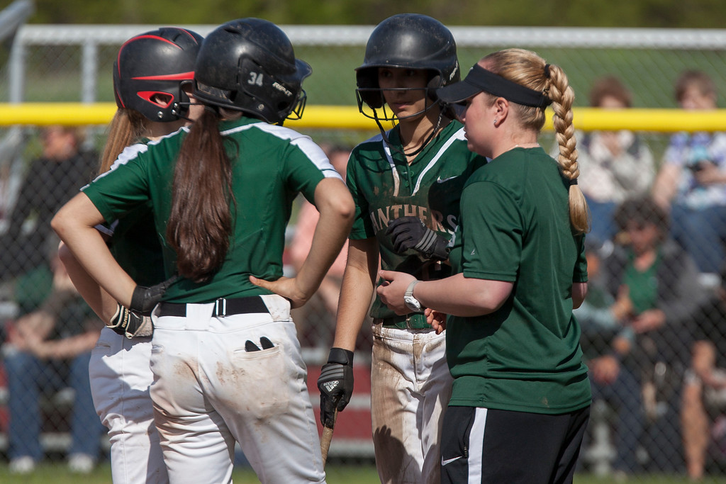 . Jen Forbus - The Morning Journal<br> Elyria Catholic coach Megan Bashak confers with her baserunners in the Panthers\' district semifinal game against the Independence Blue Devils on May 15.
