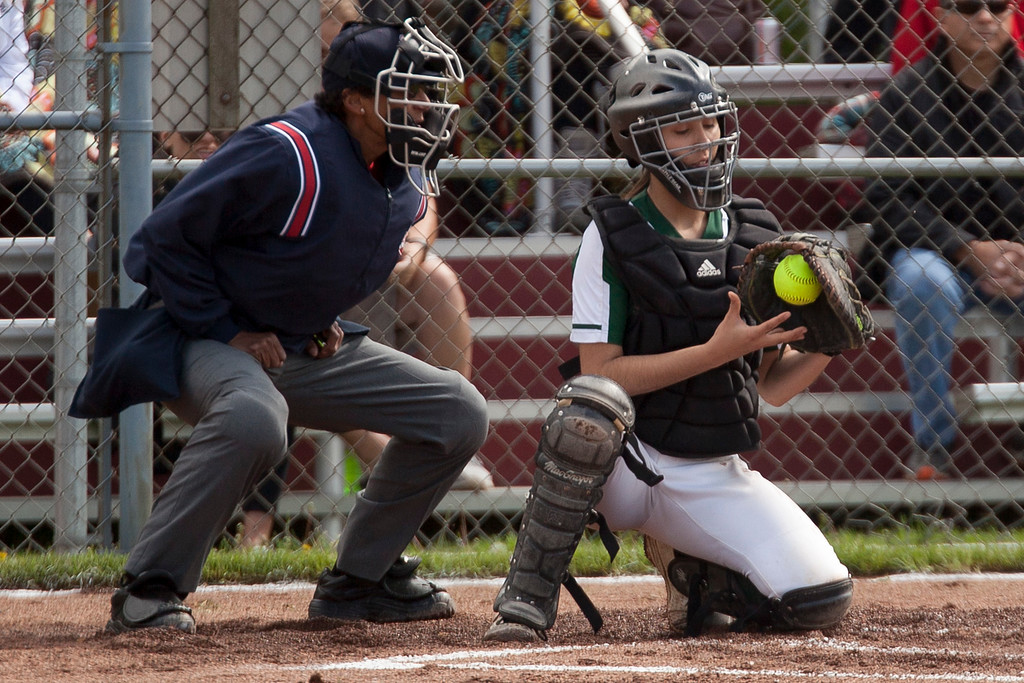 . Jen Forbus - The Morning Journal<br> Elyria Catholic catcher Kaylie Griffin controls the softball behind the plate against Independence on May 15.