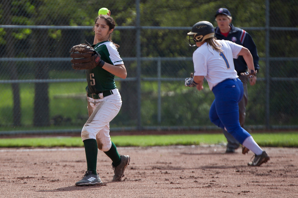 . Jen Forbus - The Morning Journal<br> Elyria Catholic shortstop Stephanie Griffin makes the throw to first against Independence on May 15.