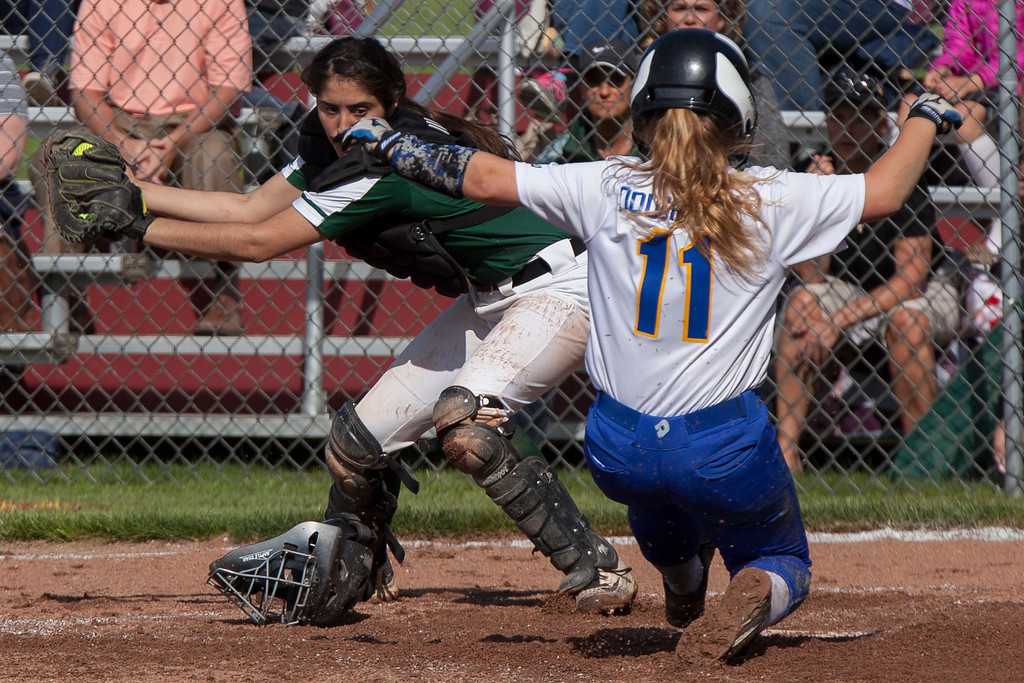 . Jen Forbus - The Morning Journal<br> Elyria Catholic catcher Kaylie Griffin takes the throw to tag Independence runner Molly Dougherty out at home on May 15.