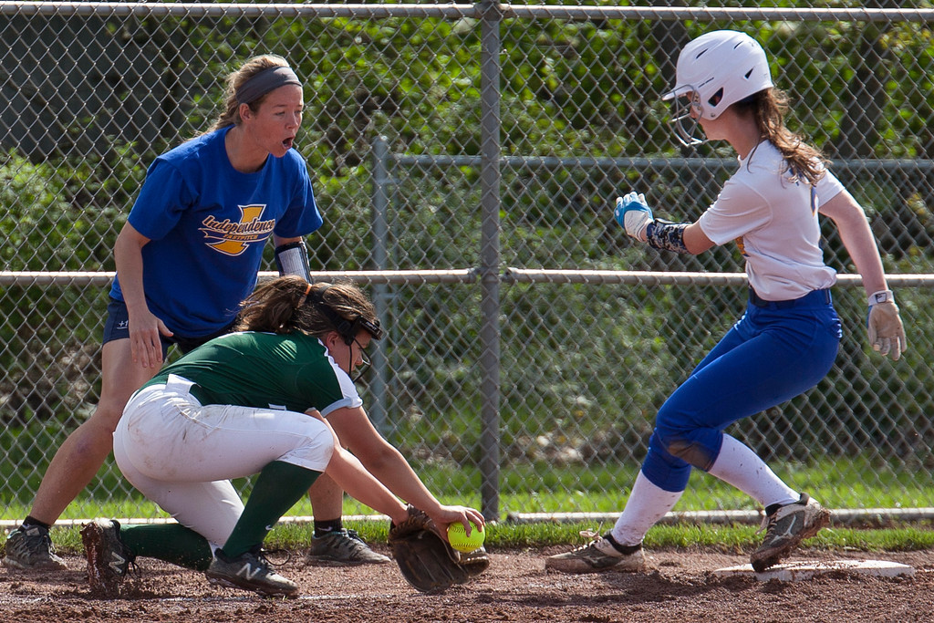 . Jen Forbus - The Morning Journal<br> Elyria Catholic third baseman Faith Beiza tries to make the tag on Independence\'s Olivia Pallini at third but comes up a little short on May 15.