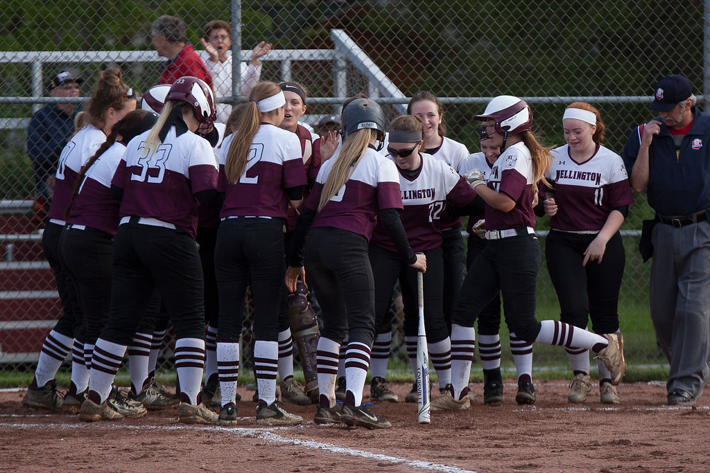 . Jen Forbus - The Morning Journal<br> Wellington gathers around home plate to welcome and congratulate Brooklinn Damiano on her home run against CVCA on May 15.