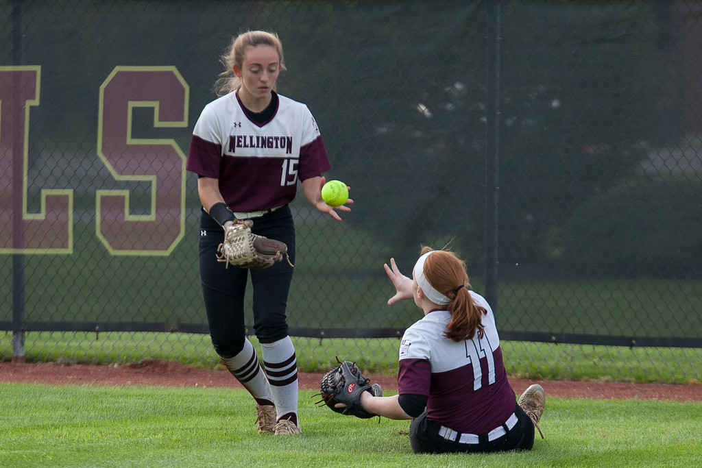 . Jen Forbus - The Morning Journal<br> Sliding in the wet grass, Wellington\'s Rianna Rosecrans, right, tosses the ball to Brooklin Damiano to get back to the infield against CVCA on May 15.