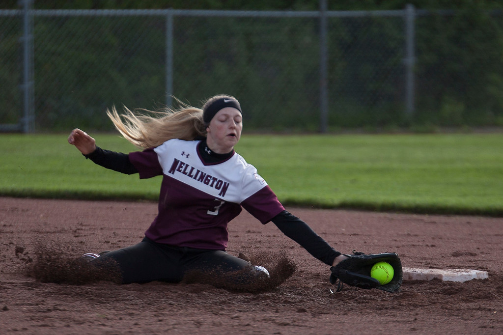. Jen Forbus - The Morning Journal<br> Wellington short stop Allissa Boraggina gets down in the mud to stop the ball in the Dukes\' district semifinal game against the CVCA Royals on May 15.