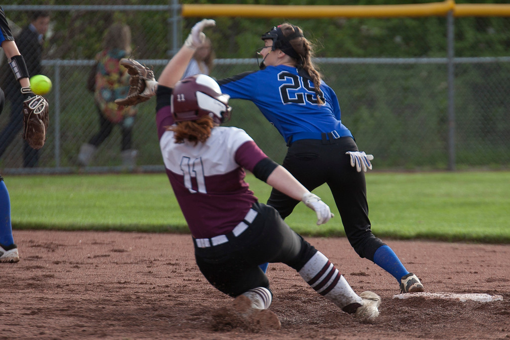 . Jen Forbus - The Morning Journal<br> Wellington\'s Rianna Rosecrans slides into second to beat the throw to Indepedence\'s Lexie Clements on May 15.