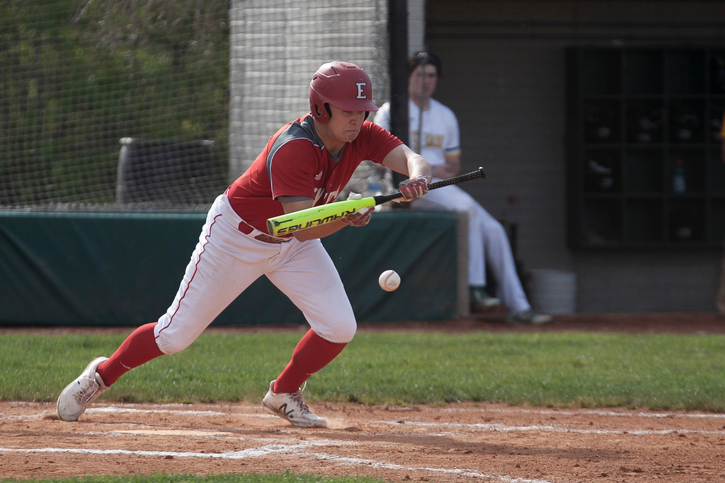 . Jen Forbus - The Morning Journal<br> Elyria\'s Carter Hyde attempts to lay down a bunt in the Pioneers\' district semifinal tournament game against the St. Edward Eagles on may 16