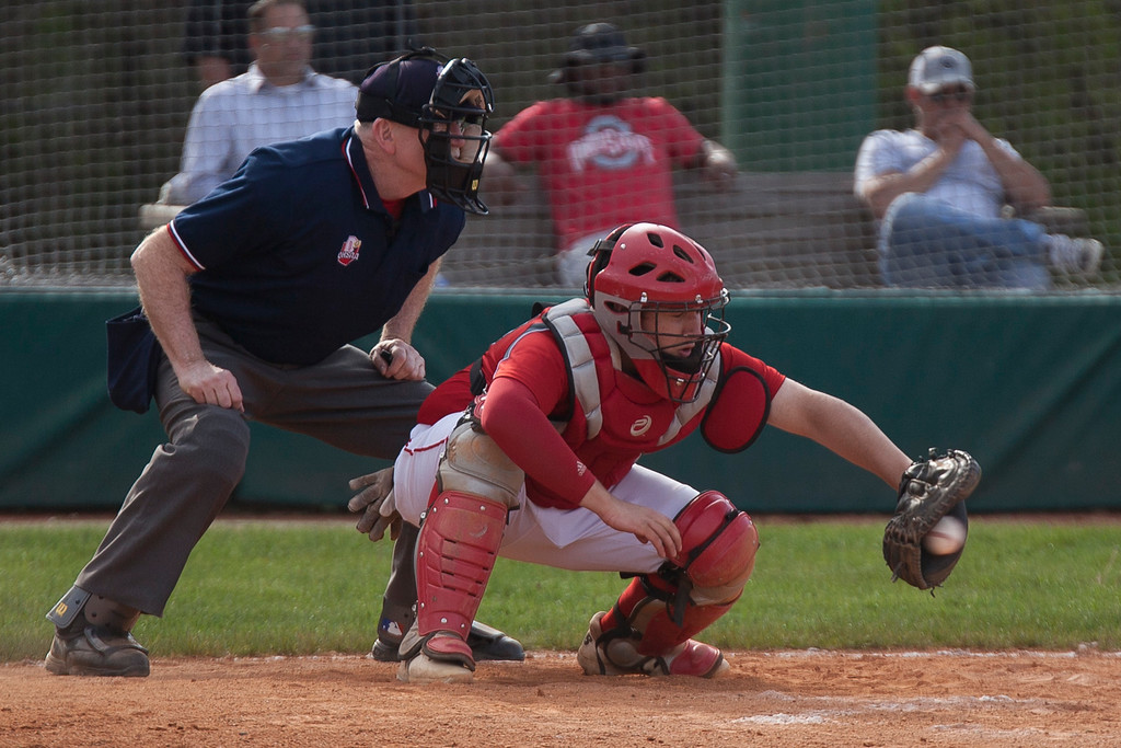 . Jen Forbus - The Morning Journal<br> Elyria catcher Max Peyton receives a pitch in Elyria\'s district semifinal tournament game against the St. Edward Eagles on May 16.