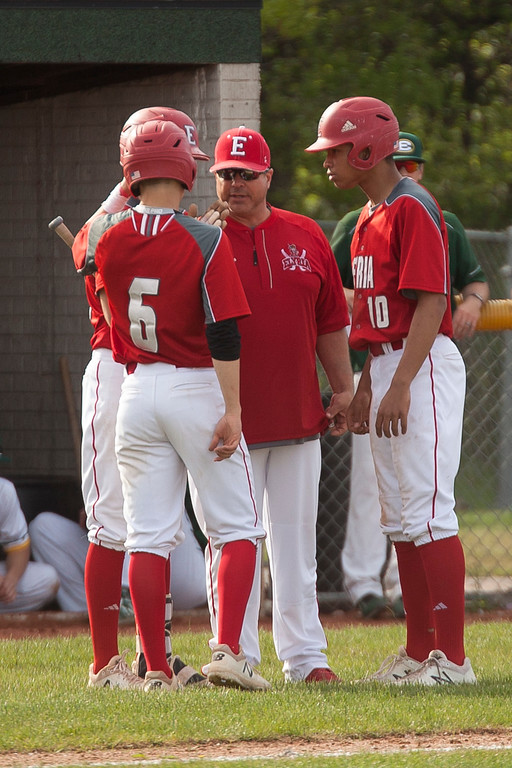 . Jen Forbus - The Morning Journal<br> Elyria coach Ed Piazza meets with his baserunners during Elyria\'s district semifinal tournament game against the St. Edward Eagles on May 16.