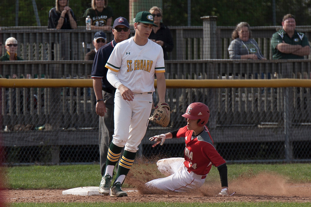 . Jen Forbus - The Morning Journal<br> Elyria\'s Hunter Osborne kicks up some mud as he slides into third base around St. Edward\'s Joe Horoszko on May 16.