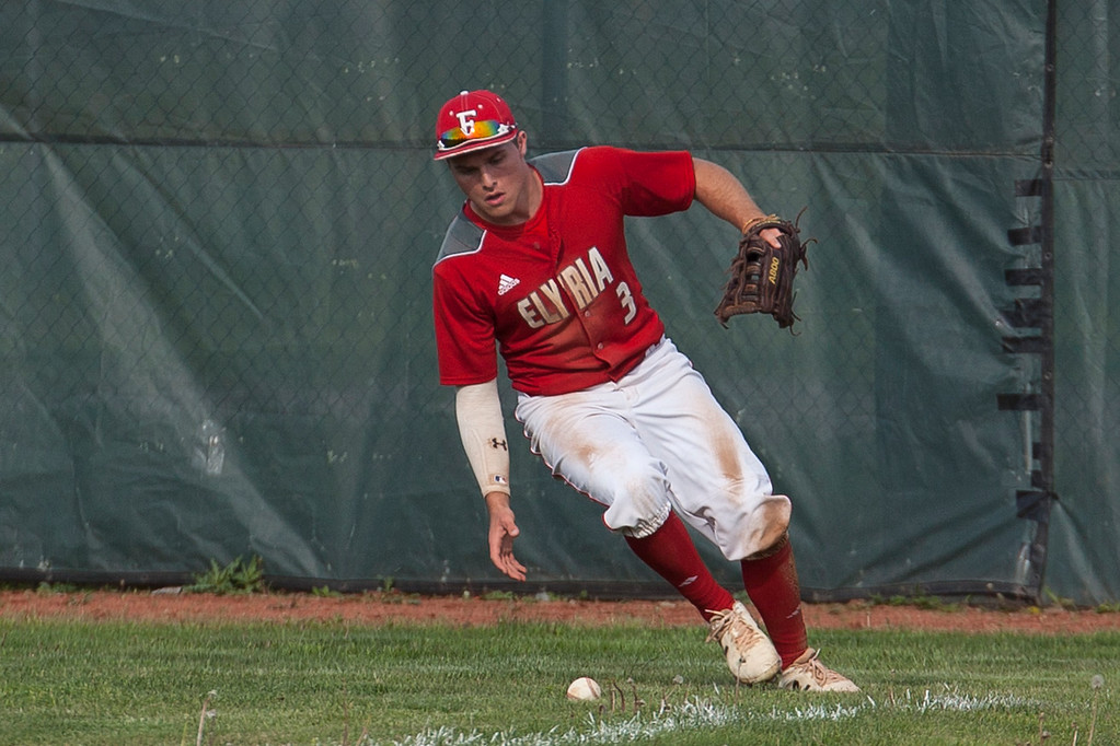 . Jen Forbus - The Morning Journal<br> Elyria right fielder Tristan Arno scoops up the ball against St. Edward on May 16.
