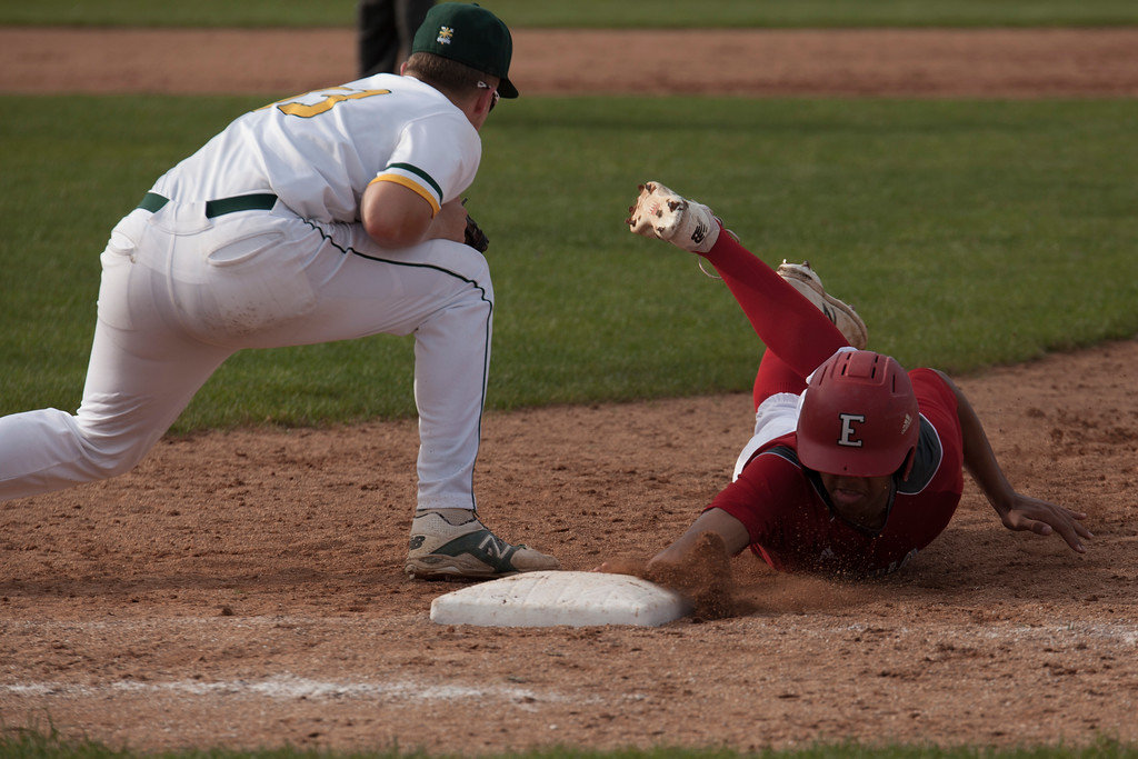. Jen Forbus - The Morning Journal<br> Elyria baserunner Steven Larkis dives back to first, beating the throw to St. Edward first baseman Spencer Cane on May 16.