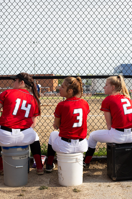 . Michael Johnson - The News-Herald Mentor Softball players sit on buckets while watching their game against Madison