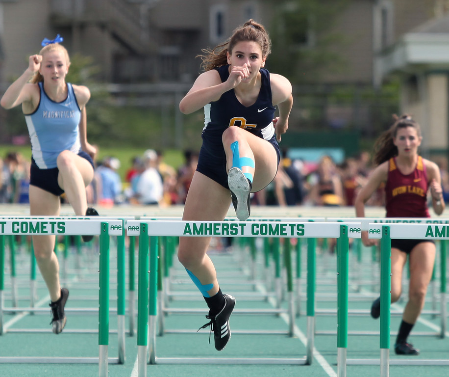 . Randy Meyers - The Morning Journal<br> Maddie Boka of Olmsted Falls clears the last hurdle in the second heat of the girls 100 meter hurdles on May 16.