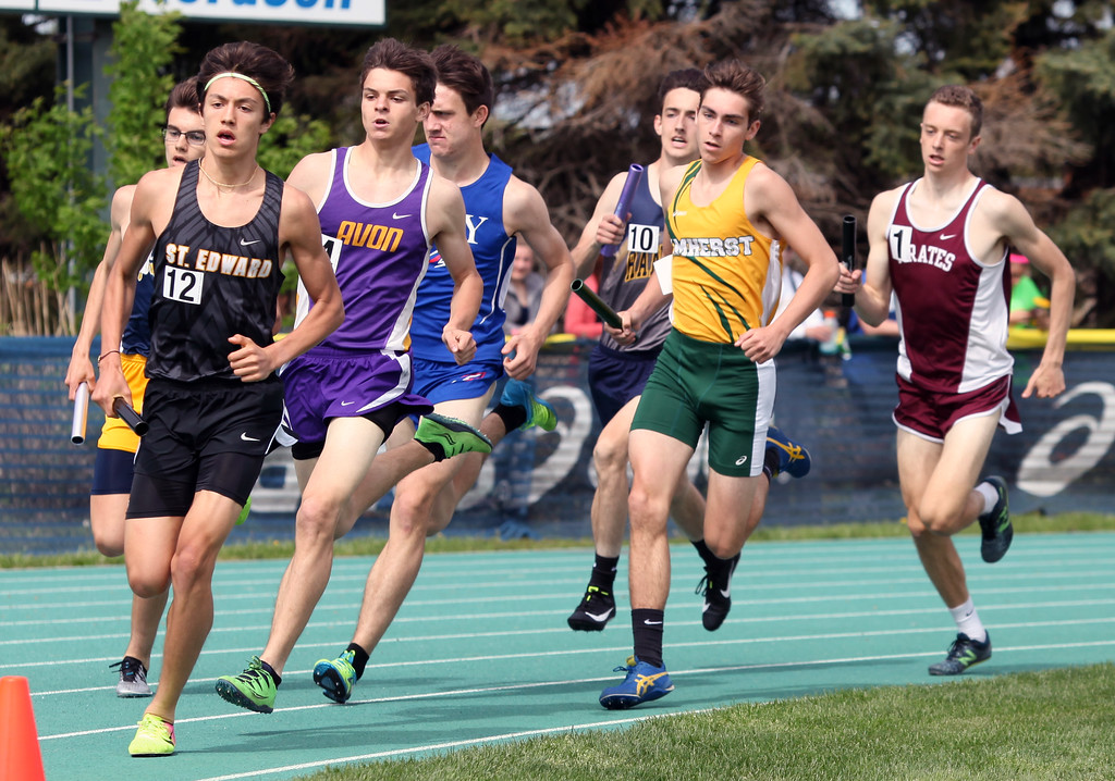 . Randy Meyers - The Morning Journal<br> Runners take the first turn of the boys 4x800 relay on May 16.
